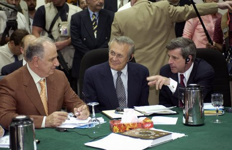 Medium ahmed chalabi in discussion with paul bremer and donald rumsfeld